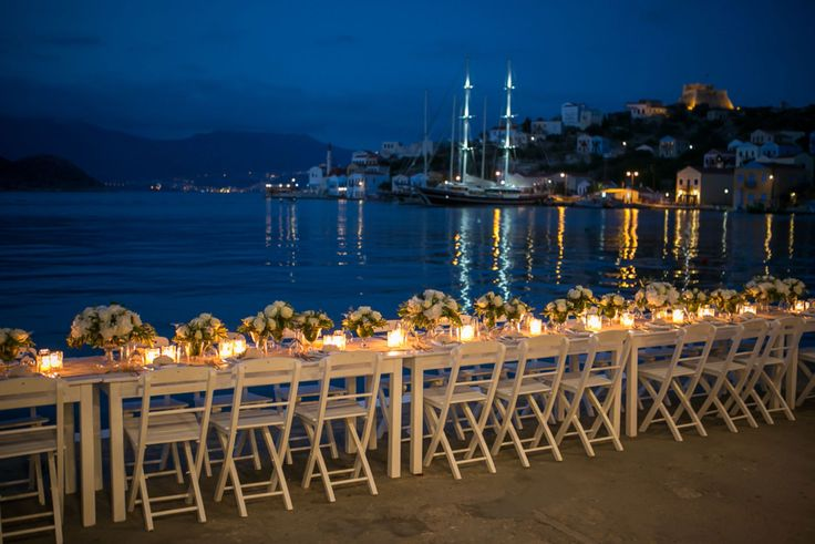 The set up of the wedding dinner in Kastelorizo is filled up with white roses and candles!
