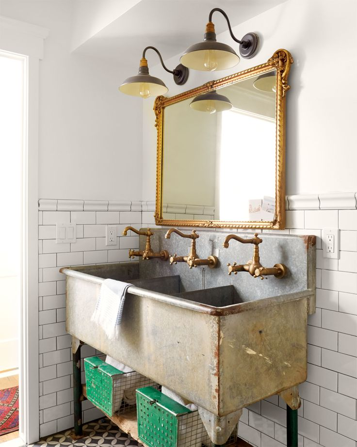 New brass faucets turned this farm sink into a stylish wash station.