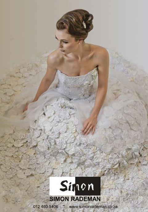 A Simon Rademan wedding dress featuring in The Wedding Collection magazine