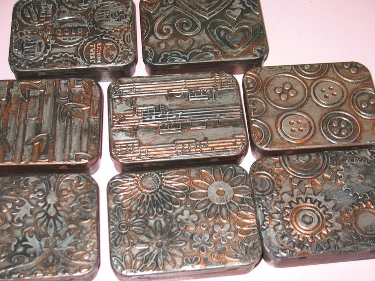Old tins, metal tape, and embossing folders