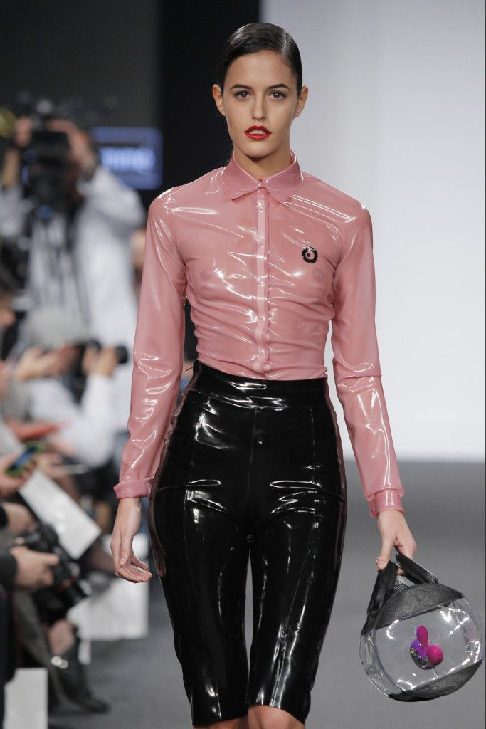 Semi-transparent pink latex button up blouse matched with black capri pants.  Collaborated on by Lelo and Madrub.. Buy the supplies to make this: http://mjtrends.com/pins.php?name=semi-transparent-pink-latex-for-clothing