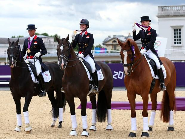 Team GB's dressage team won gold on day 11 of the Olympics: Carl Hester on Uthopia, Charlotte Dujardin on Valegro and Laura Bechtolsheimer on Mistral Hojris