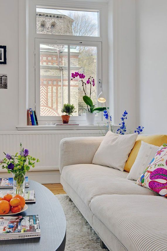 Ideas And Inspiration For Organizing Small Living Rooms 20 - I like the white with pops of colour