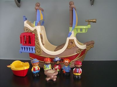 elc happyland pirateship with 5 pirates, table and a small boat