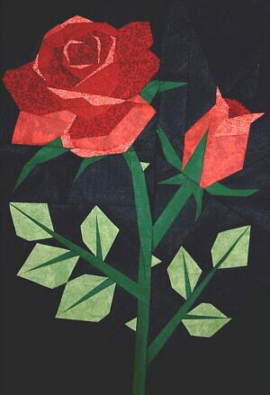 Paper pieced Rose and several other patterns.
