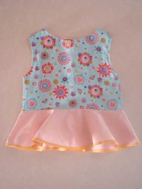 FREE SEWING PATTERN: Download the peplum top pattern for girls. PDF sizes from 12 months to 8 years. Printable file to use at home. CHECK THIS OUT!!!