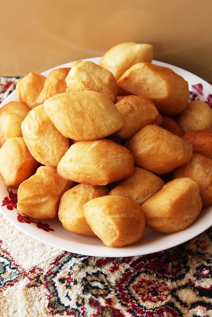 Baursaki are a variety of doughnut-like pastries from Kazakhstan. They consist of fried dough, and are shaped into either spheres or triangles. The dough consists of flour, yeast, milk, eggs, margarine, salt, sugar, and fat. Baursaki is often eaten alongside Chorba.