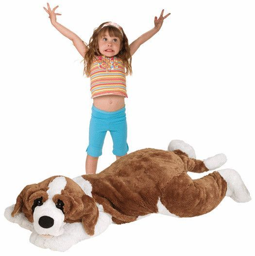 JooJoo Plush 60 Inch Jumbo St. Bernard - This cute, cuddly St. Bernard is a huggable delight for any animal lover. Extremely silky soft with soothing, friendly features. Sure to be a family favorite for St. Bernard years to come. Fuzzy buddy makes a lasting impression as a gift or on display. Great item to be displayed on your little one�s bed. For ages 3 years and up. 5 Feet Long!!!!. Gifts > Toys > Plush Toys. Weight: 7.00