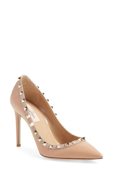 "Free shipping and returns on Valentino 'Rockstud' Pump (Women) at Nordstrom.com. <p><B STYLE=""COLOR:#990000"">Pre-order this style today! Add to Shopping Bag to view approximate ship date. You'll be charged only when your item ships.</b></p><br>Gilded pyramid studs add edgy opulence to an iconic pointy-toe pump shaped from smooth leather."