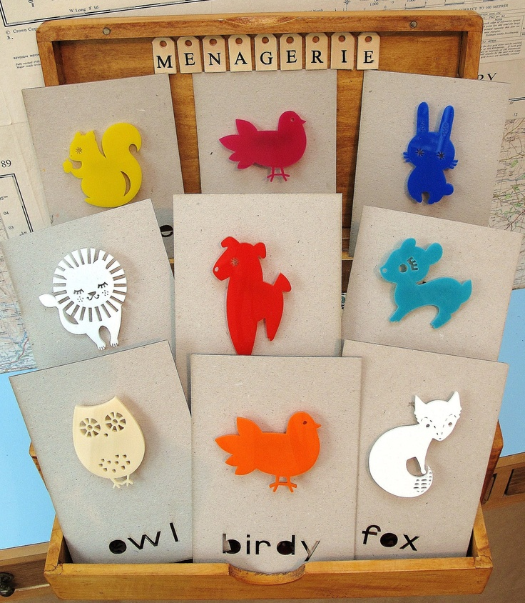 Laser cut animal jewelry on cards with name of animal laser cut
