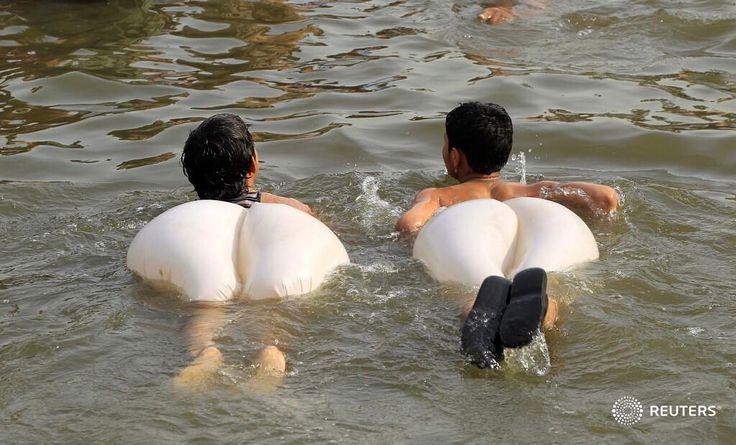 Boys swim in a stream during a heatwave in Islamabad, Pakistan June 5, 2017. REUTERS/Caren Firouz @cjfirouz #pakistan #weather #reuters #reutersphotos #water
