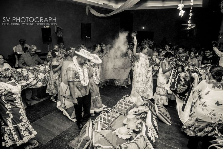 On Austral's island there is a tradition to bless the couple : offer a lot of gift from all family, dance and bless them with white powder Destination Wedding Photographer, Tahiti, Moorea, Bora Bora http://www.svphotograph.com #svphotograph #destinationweddings #tradition #white #blackandwhite #powder #fun #wedding #weddinginspo #dance #tahiti  #flowercrown #party