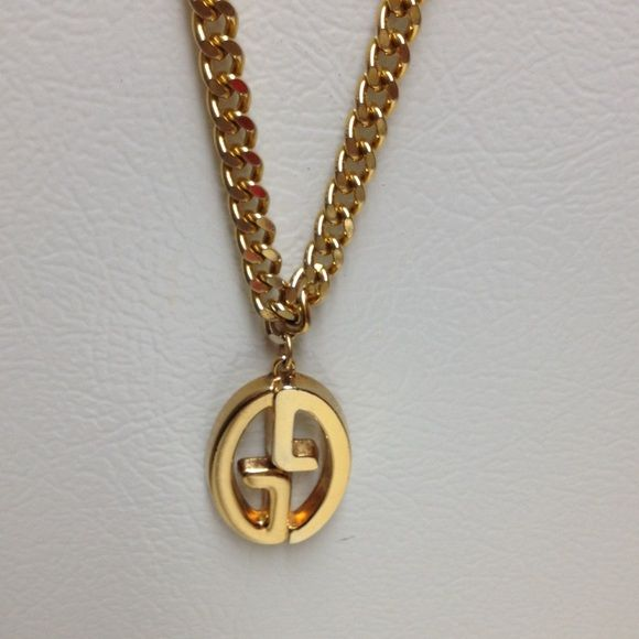 GUCCI Auth Vntg 14k plated medallion n phony chain GUCCI Authentic Vintage 14k gold plated medallion (on a Not real gold chain). Gucci Italy stamp on back of medallion only, (not chain). Recently the medallion was re-plated in 14k gold. Very heavyweight.  Perfect for the man or woman who loves Gucci. Chain was originally a belt and is not real gold and missing the clasp.  Will fit over most men's heads. Gucci Jewelry Necklaces