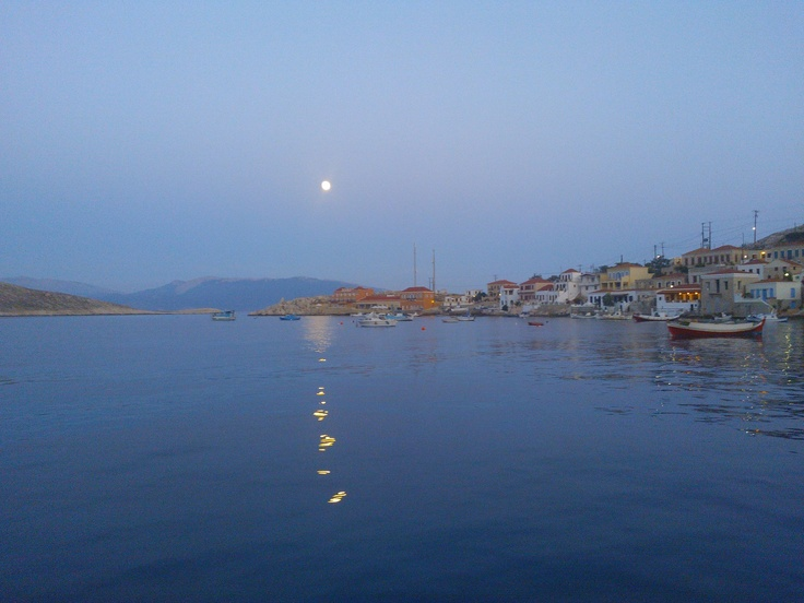 Chalki island, near Rhodes, walking at the small island port, at 9pm.   Crystal waters, shiny moon...