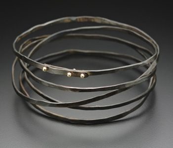 Peg Fetter: Wrapped, Bracelet in steel and 14k yellow gold.