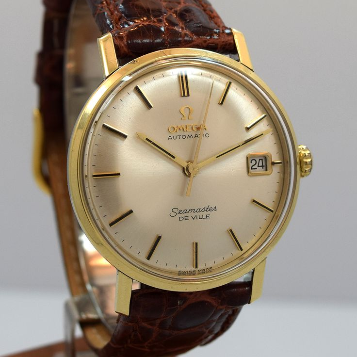 This outstanding 166.020 reference of the Omega Seamaster DeVille was manufactured in 1963. This timepiece, with a smooth 14K yellow gold bezel exhibits a magnificent, patinated silver dial with a date function and applied gold stick markers. At 34mm, this Omega wears comfortably and is fitted with a caliber 562 automatic movement. (Store Inventory # 9897, listed at $1650).