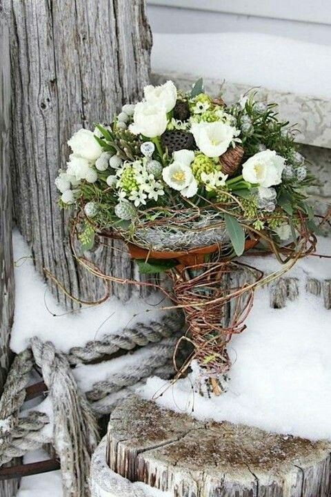 Beautiful Winter Wedding Bouquet Featuring: White Fringed Tulips, Star Of Bethlehem, Silver Brunia, Dried Lotus Pods, Green Eucalyptus, Additional Coordinating Florals & Foliage & Dried Vine