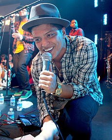 Bruno Mars ~ His father is of half Puerto Rican and half Jewish (from Hungary and Ukraine) descent, and is originally from Brooklyn, New York.[9][10] Mars' mother immigrated to Hawaii from the Philippines as a child, and is of Filipino and some Spanish descent
