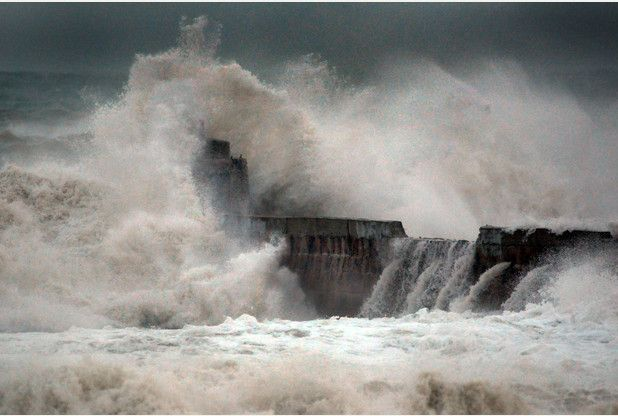 Now you see it: The 18th century pier at Portreath on Cornwall's north coast just before its 'monkey house' was washed away by the massive Atlantic breakers of Winter Storm Hercules on January 6, 2014. Picture: Colin Higgs