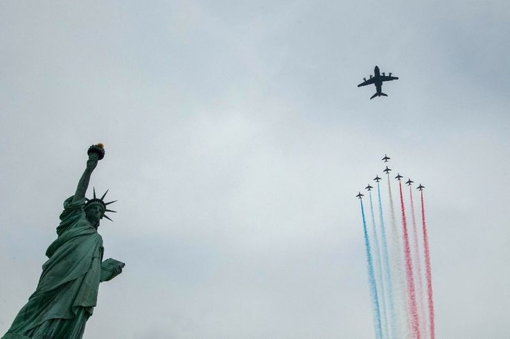 La Patrouille de France fly over the Statue of liberty, as part of a 6-week tour of the US, in New York© 2017 AFP