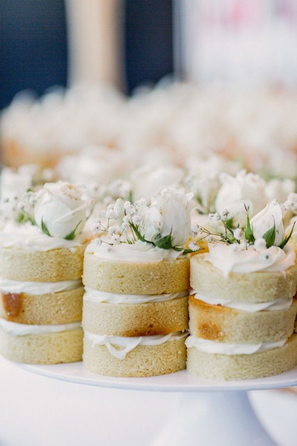 Gorgeous mini wedding cakes topped with white roses and Baby's Breath. See more images of this #realwedding here: http://www.easyweddings.com.au/real-weddings/tammy-jean-celebrate-10-years-vow-renewal-sydney-harbour/