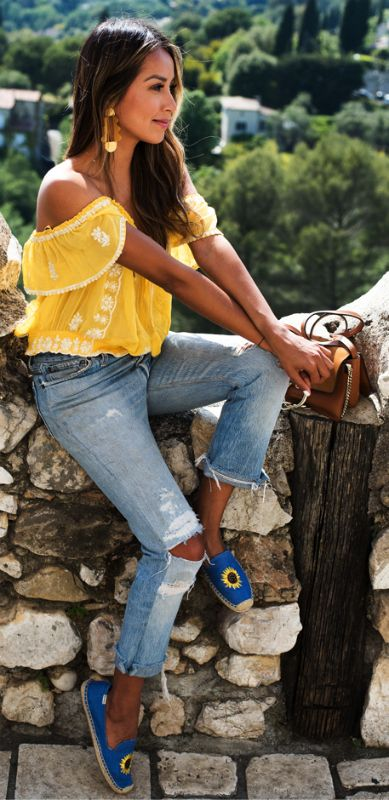 bold, bright-coloured item + show your summer side + Julie Sarinana + vibrant and feminine yellow off-the-shoulder top + distressed jeans + lovely floral espadrilles   Espadrilles: Saludos, Jeans/Top: Brands not specified