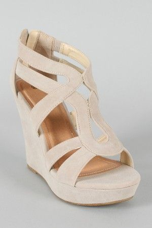 This cut-out wedge will make your look effortlessly chic. Features open toe front, strappy construction at vamp, stitching details, covered platform, and wedge heel. Finished with lightly padded insole and rear zipper closure for easy on/off.