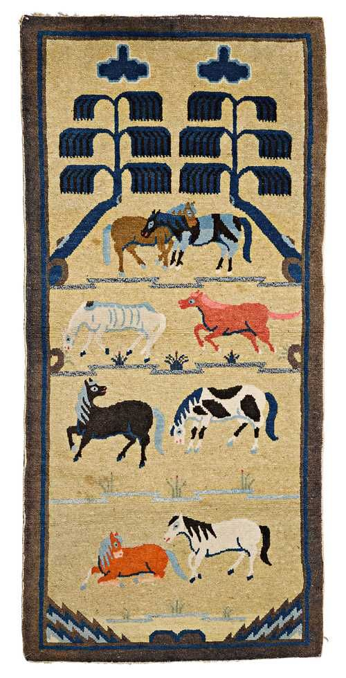 A WOOLEN BAOTOU CARPET WITH THE EIGHT HORSES OF EMPEROR MU. China, ca. 1900, 147x72 cm. Some spots.
