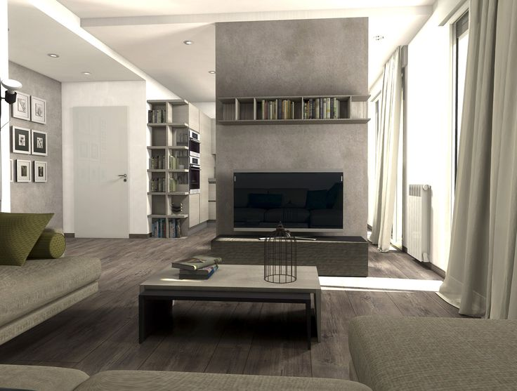 Eliminando l'ingresso e la netta separazione tra soggiorno e cucina, con una quinta a doppia funzione la casa guadagna in funzionalità e diventa più vivibile e contemporanea.