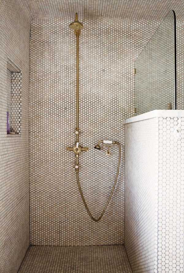 shower with creamy penny tiles, touches of marble and brass fixtures | via coco+kelley