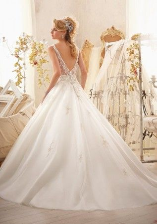 2618 by Morilee is a wedding gown that turns you into the belle of the ball. It features a see through back and fully beaded v neck bodice all atop a gorgeous tulle ballgown skirt. Available at Bridal Exclusives Portland, Oregon. Click to make an appointment!