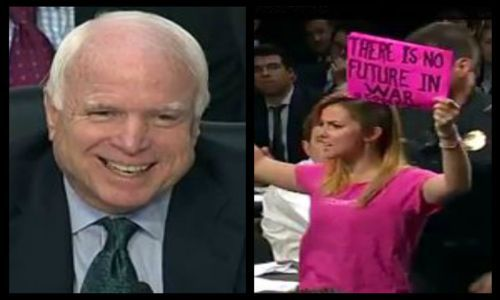 Senator McCain laughs at anti-war protesters as they're kicked out of ISIS Senate hearing