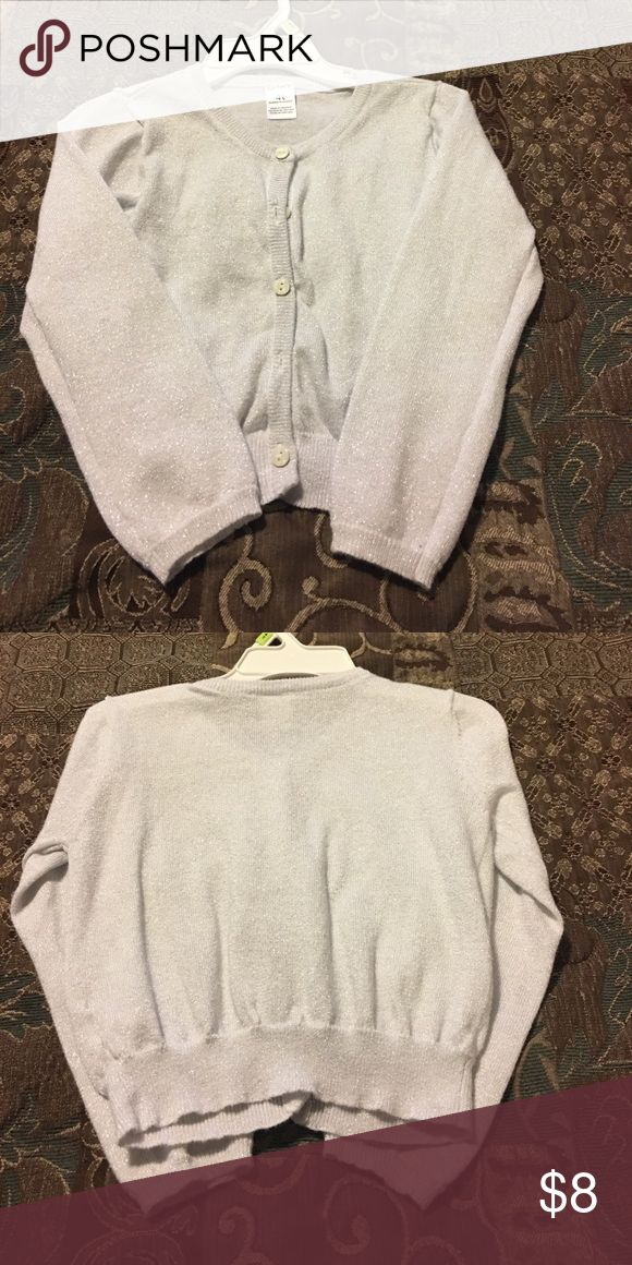 Carters 4T silver cardigan 💖💕💗 This is a fun and sparkly silver cardigan for a little girl 💖💗💕. It was worn maybe two or three times at the most so it's in really good shape 😊. It's so cute ☺️ Carter's Shirts & Tops Button Down Shirts
