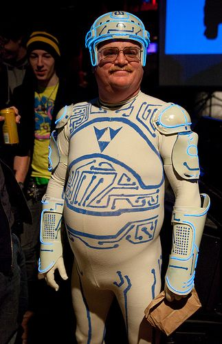 "Top 10 Cosplay Costumes So Bad, They're Awesome - Tron Guy  tron-guy  If you've been on the Internet for any length of time, you've seen Jay Maynard and his Tron costume. Jay turned a reasonably-OK fan costume into a career, to the point where he's now universally known as ""Tron Guy.""  Read more: http://www.toptenz.net/top-10-cosplay-costumes-so-bad-theyre-awesome.php#ixzz2PEcaFI1v"