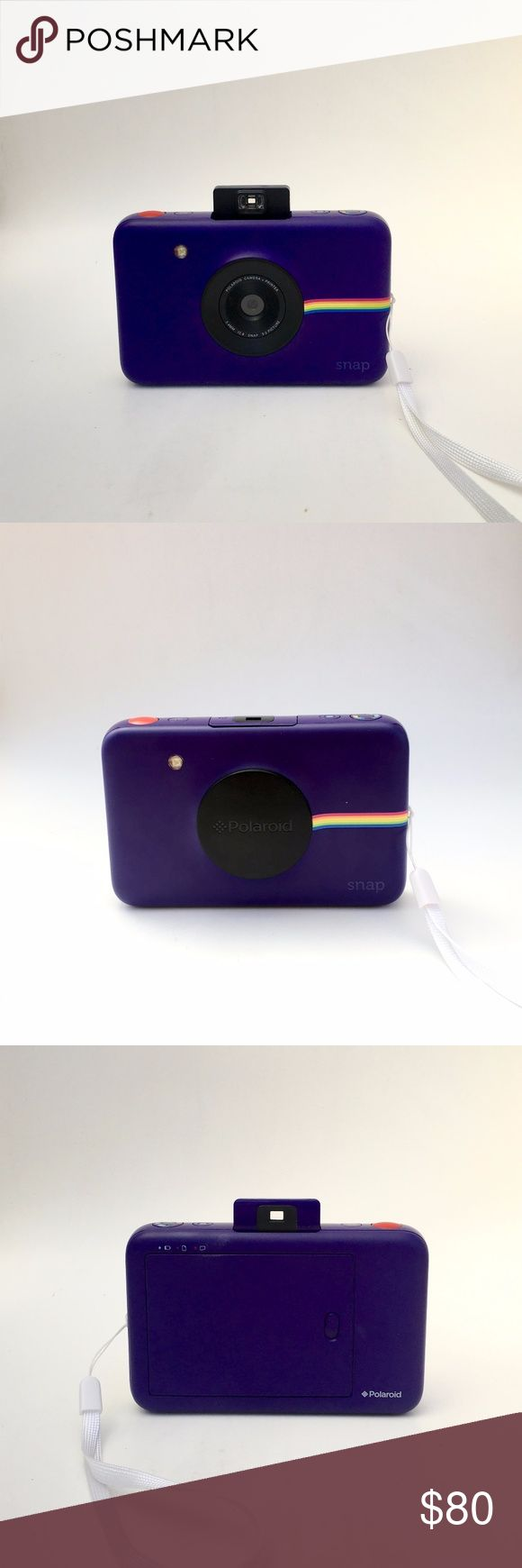 """Polaroid Snap Instant Digital Camera Used, in like new condition, fully functional Purple Polaroid Snap 10 megapixels normal, black & white and vintage sepia tone  MicroSD card indicator Self timer feature Image prints automatically 2x3"""" full color prints  Comes with charging cable Polaroid Accessories"""