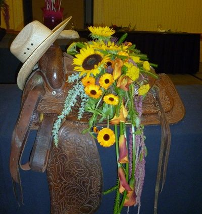 floral arrangements designed in a western saddle | ... Zen garden design, and a saddle with flowers became a casket spray