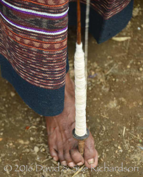 Unwinding a drop spindles at Napasabok, Kecematan Ile Api, Lembata Island