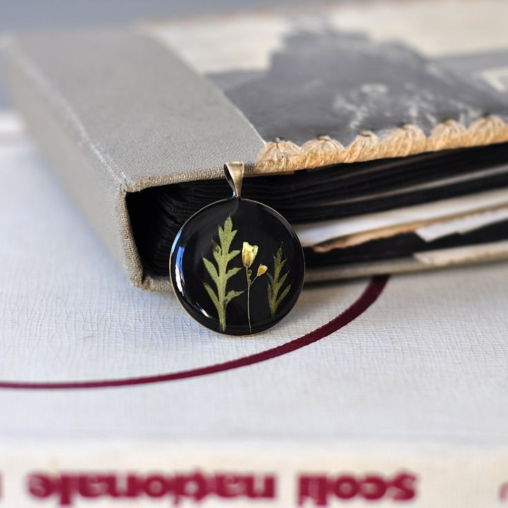 'garden mix' plants preserved in resin on a brass pendant. by Pebs