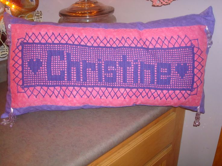 Filet crochet attached to a pillow.