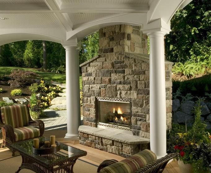 Outdoor Stone Fireplace And Stone Hearth Round White Columns And Outdoor Lounge With Class And Wicker Coffee Table Parmenter Homes Pinterest Wicker