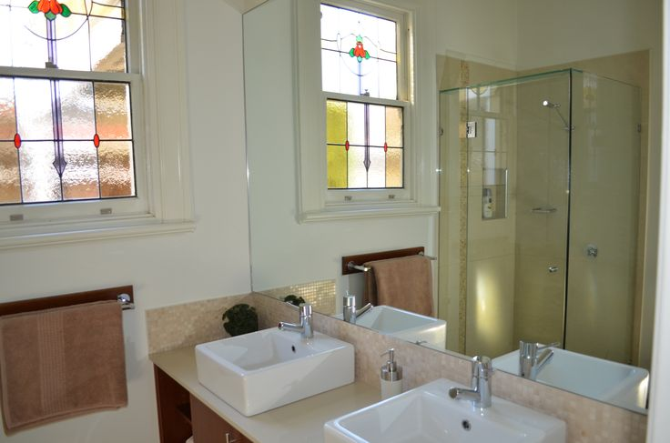 Ensuite bathroom.  Traditional house.  Stained glass window. Double vanity. Neutral scheme.  Lisa Banducci Design.