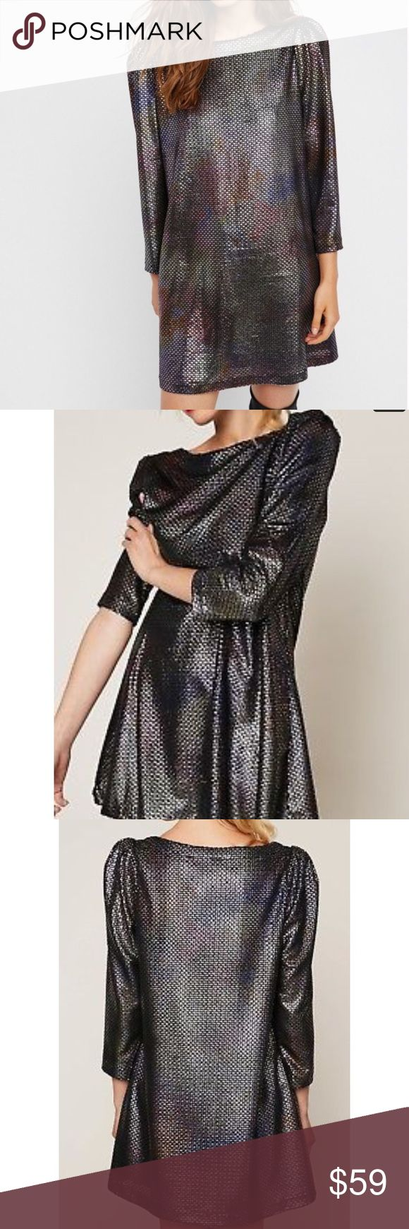 """Free People Diamonds are Forever Dress! So pretty! NWT. Size Large Shine on in this long sleeve metallic mini dress featuring structured shoulders and a swingy silhouette.  Side pockets Care/Import  Hand Wash Cold  Import  Measurements for size L  Flat chest measures 22"""" Length: 34 in Sleeve Length: 21.5 in Free People Dresses Mini"""