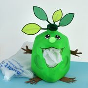 Stuff your plastic bags into this green guy bag caddy made from a milk jug. Great idea.