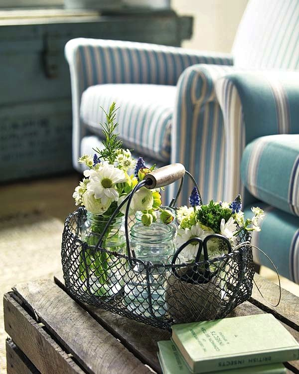 I love the flowers and greenery in the glass vases with the wire basket. So pretty