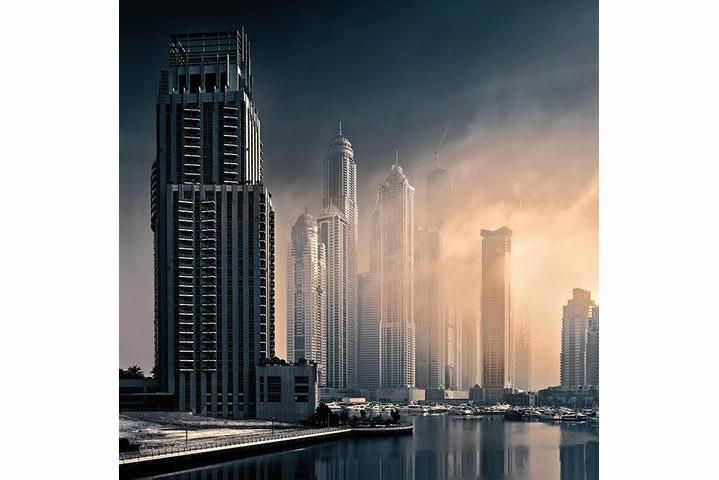 "Cloud City', by Beno Saradzic  ""Featured is the 'Tallest Block in the World' at Dubai Marina on a misty morning. I was instantly attracted by the mysterious quality of light and the warm tones veiling the buildings. It was a rare and unusual sight which I wasn't going to miss. Luckily, I had the camera and the tripod in my car's trunk. I quickly snapped a few exposures which later turned to be on my favorite exposures of the past few years."""