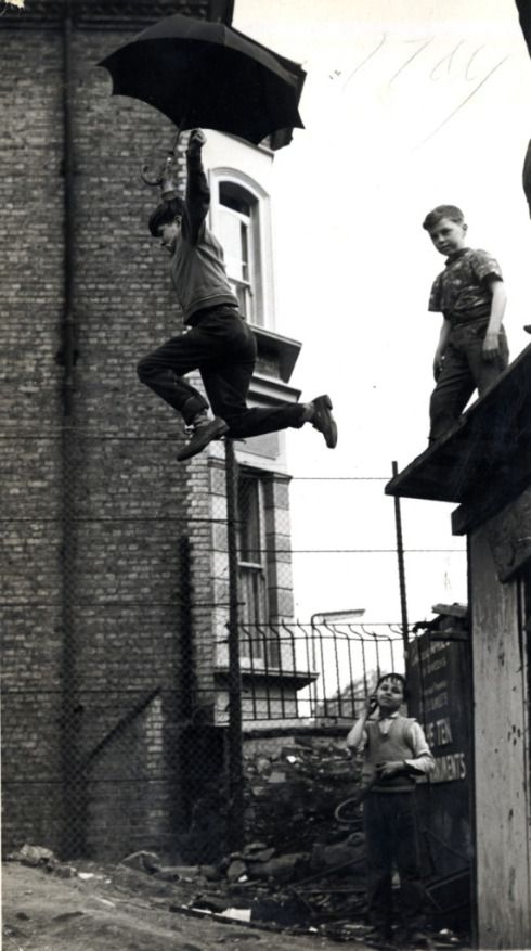 This umbrella leap is from 1963 – the image was used as part of an appeal for the London Adventure Playground Asociation.