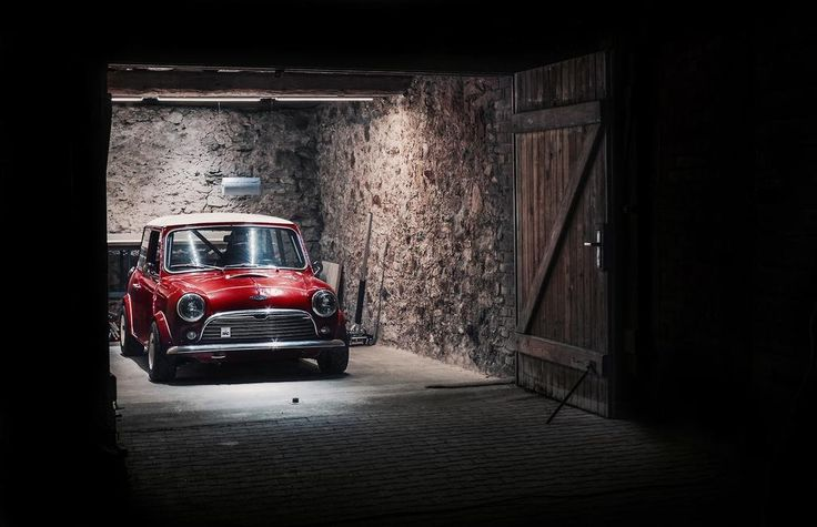 Bright red Classic Mini Cooper in a wooden shed