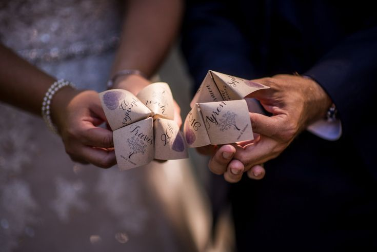 Bride and Groom hold their chinese fortune teller wedding favors #wedding
