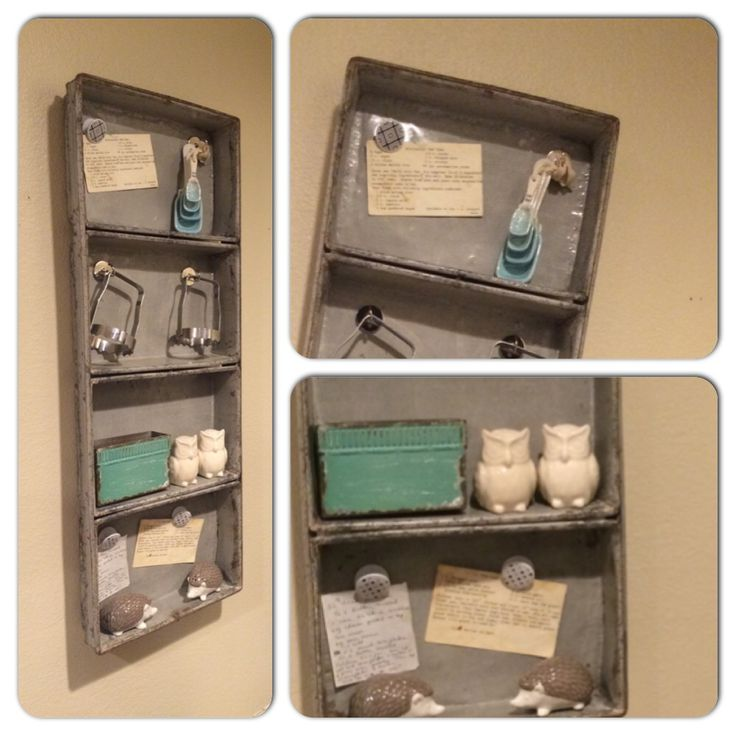 Vintage metal loaf pan repurposed as a kitchen shelf. Magnets to hold old recipe cards and kitchen tools.