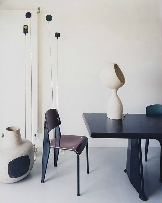Philippe Jousse, Paris - Grazia Casa - photo by Simon Watson. Ceramics and lamp by André Borderie and chair by Jean Prouvé
